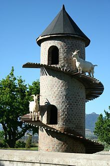 A Goat Tower is a decorative goat house, modeled on a European garden Folly, an early example of which was built in Portugal in the 19th century. A South African goat tower at Fairview Winery was built in the 20th century and became famous, inspiring additional copies throughout the world.