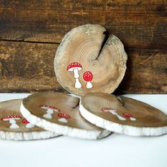Wood burned and painted mushroom design on driftwood slice coasters. Set of 4 rustic wood coasters with rubber bumpers. Fly agaric deign