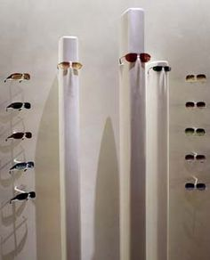 The ethereal presentation of eyewear at Oliver Peoples' new South Coast Plaza store won the project an award from the National Association of Store Fixture Manufacturers for best fixture program. Clear glass and LED lighting gives the expensive fashion frames the appearance of floating.  View Image Details