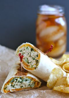 Crispy Chicken Salad Wraps: The most flavorful chicken salad you'll ever eat is rolled up in a tortilla with extra-sharp cheddar, and cooked in a skillet for a quick, delicious, and CRISPY lunch!