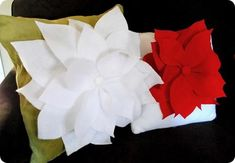 Light up your living rooms with these poinsettia Christmas pillows! They shine as bright as the Nativity star inviting jolly good cheer into your homes! All you have to do is sew the red or white felt petals together and you're ready to go. Try spraying your favorite fragrance on them to complete the whole poinsettia experience!