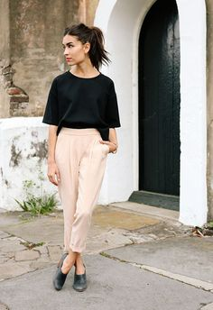 Black loose cut top, pastel pink trousers / pants and black shoes from Nisolo