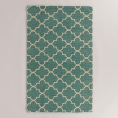 A chic update to traditional Moroccan rugs with a smooth boucle texture, our exclusive area rug is artisan-woven in India of 100% jute and printed with our lattice design against a soft blue background.