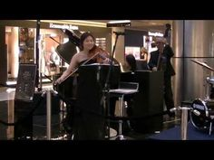 """Lim Hui performing """"Desafinado"""" at Paragon Shopping Centre.  """"Desafinado"""", a Portuguese word (usually rendered into English as """"Out of Tune"""", or as """"Off Key""""), is the title of a bossa nova song composed by Antonio C..."""
