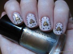 Dotted heart nail art