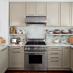 the homeowners wanted to revamp their kitchen, but did not want the expense of new cabinetry, so they raised them, allowing room for some open shelves, added some new hardware, a fresh coat of paint
