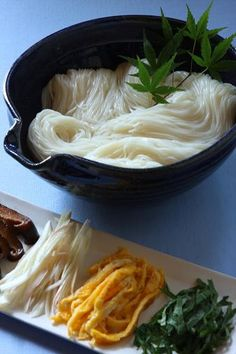 Asian noodles cooked in fish or chicken juice. Add to cooked noodles; sliced shitake or enoki mushrooms, fresh basil and mint and cilantro, thinly sliced meat or egg, squize of lemon.