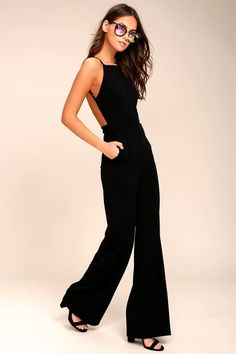 The night is yours in the Something to Behold Black Jumpsuit! Sleek stretch knit forms this sexy jumpsuit with an open back and wide pant legs. Formal Jumpsuit, Backless Jumpsuit, Jumpsuit With Sleeves, Black Romper, Schwarzer Overall Outfit, Dressy Rompers And Jumpsuits, Jumpsuits For Women Formal, Romper Outfit, Black Jumpsuit Outfit Night