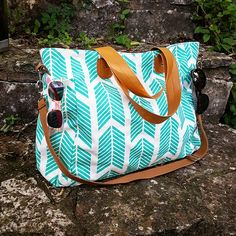 Take it all with you with this stylish Teal Arrows Weekender Tote Bag! This bag…