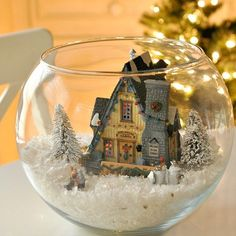 Bring a little wintery magic inside with a DIY snow globe complete with a lighted house