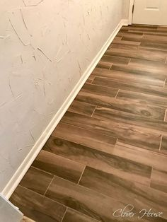 Did you recently retile your floor? If you're like me, you did it yourself (or your handy husband did it). Doing it yourself can be budget friendly, but you don't always get that picture perfect finished look. Here is how we gave our floor that picture perfect finished look. #diy #flooring #tiles #woodfloor #budgetdiy #diyflooring #hometalk #baseboards #perfect #professional #budget