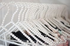 Now this is pure luxury ~~ pearl coat hangers!