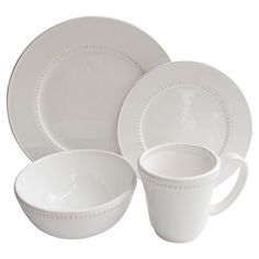 Showcasing a crisp white finish and textured edge, this earthenware dinner set brings sophisticated appeal to your tablescape.  Prod...