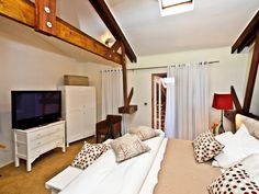 Unit 3A:  Top floor air-conditioned bedroom with king size bed & flat screen TV.