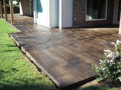 Concrete that's been stamped and stained to look like hardwood. What a fabulous idea!!