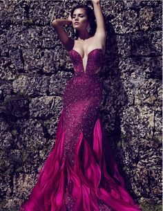 Magenta beaded gown, custom Magenta-Strapless low V neck line gown.. For Custom Orders contact Paul at edelascasas@aol.com
