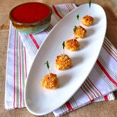Cashew and Pine Nut crusted mozzarella balls with a marinara dipping sauce.