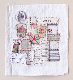 Small art quilt on antique cloth, Textile Tokens No. 2. $55.00, via Etsy....interesting work