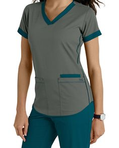 NrG by Barco brings to you this cute scrub top highlighted by contrast banded sleeves, neck and piping details on sides and hem. V-neck Three pockets Fitted back Contrast details Medium center back length 26 Scrubs Uniform, Scrubs Outfit, Medical Uniforms, Work Uniforms, Jaanuu Scrubs, Scrubs Pattern, Doctor Scrubs, Cute Scrubs, Womens Scrubs