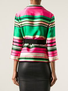 Pink and green jacket, black skirt