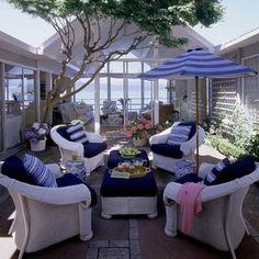 A Japanese maple tree shades this open atrium. | Coastalliving.com