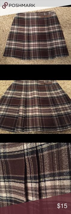 Plaid checkered mini skirt vintage 90s It's plaid checkered vintage 90s mini skirt. Brown and tan. Size 9 juniors. Measures 16 inches long and 13.5 inches across waist when lying flat. Tracy Evans Skirts Mini