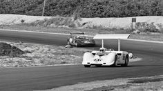 Jim Hall powers his Chaparral 2G around Bridgehampton during the 1967 Can-Am race. Behind is Scooter Patrick in his Mirage M1B. Stanley Rosenthall photo.