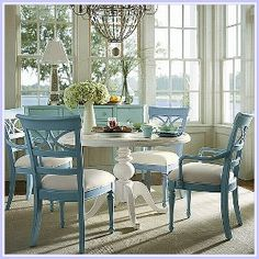 Love a round table with a pedestal.  Painted chairs look casual and comfy.