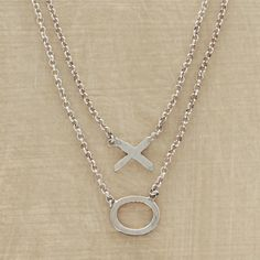 X O Necklace  Companion necklaces to wear together or share with a friend. Delicate chains in recycled sterling silver are the bearers of hugs and kisses. Handcrafted in USA. Set of 2. $148