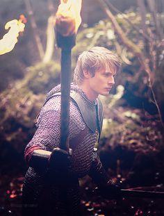Bradley James as Arthur in Merlin
