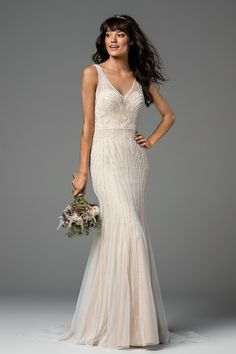 The exquisitely crafted Oceana from the Willowby Collection by Watters features geometric elements for a cut-from-the-earth aesthetic. This gorgeous English netting and stretch Poly Charmeuse gown is covered in beading from head-to-toe! With it's intricate design and delicate features, this gown is definitely for the one of a kind bride.