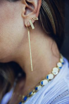 Jennifer Wears A Custom Earring For Her Son Otis With The Long Stick And Rectangular Stud