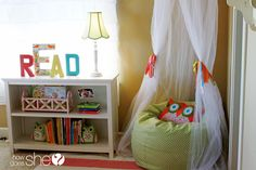 I love this little girl's bedroom with a book nook and writing space-- inspiring readers and writers! (howdoesshe.com)