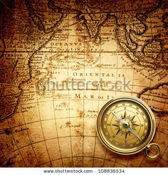 old compass on vintage map 1746 by Triff, via Shutterstock
