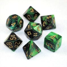 A RPG dice set from the Chessex Gemini™ Series. Each Gemini™ polyhedral dice set is swirled with two different twin colors, creating a magical effect. Ranger Dnd, Dice Box, Easy Shape, Pearl Design, Dark Interiors, Geek Out, Dungeons And Dragons, Green And Gold, Decir No