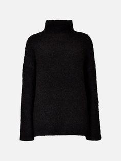 Høyhalset bouclestrikket genser. Løstsittende passform.  Svart