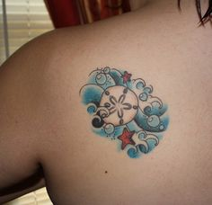 "I honestly don't have any life changing story about this tattoo other than that the first time I went to the beach, I found a sand dollar and said ""I will get this tattooed on my body"". I have just always thought they were neat. Artist: Nathan B. Location: Freak on Broadway, Westport KC."