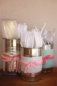 The Frosted Petticoat: Yarn Baby use scrap book paper to cover tin cans to match your party decor.
