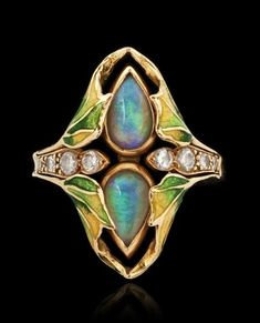 Gold, opals, diamonds and enamel Art Nouveau ring. #opalsaustralia