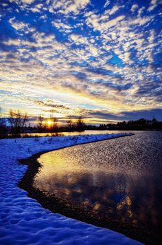 Icy Lake With Glowing Sun Rays – Stock Image