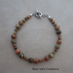 An autumn jasper bracelet. Jasper is associated with balancing physical, emotional, spiritual and intellectual energies. This stone resonated with the solar plexus chakra.