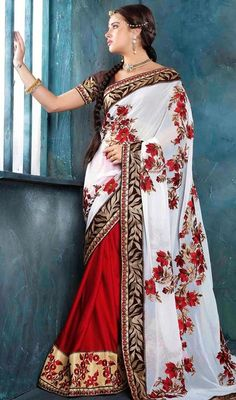 Flaunt a laid back style dressed up in this red and white chiffon georgette half n half sari. Beautified with floral patch, lace and resham work. #PlushyRedAndWhiteFlowerVinesDesignSari