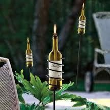 Recycled wine bottles as torches. Can use regular oil or citronella