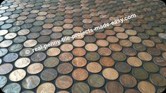 Black sanded grout on pennies.