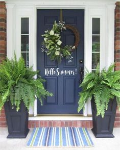 Navy blue front door with tall fern planters That's my brick. I never would have thought navy blue. I love it My Blue Front Door: front door color is Sherwin Williams Naval. The perfect navy blue for entry doors or a front door with sidelights. Best Front Doors, The Doors, Entry Doors, Navy Front Doors, Dark Front Door, Entry Door With Sidelights, Beautiful Front Doors, House Beautiful, Painted Front Doors
