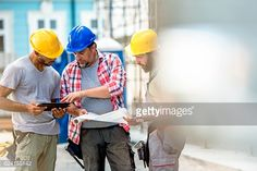 Stock Photo : Three construction workers preparing for work