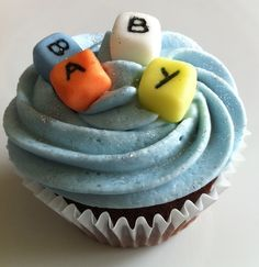 Blocks on the simple vanila cupcake with blue frosting on top -Nice Baby Shower Cupcakes