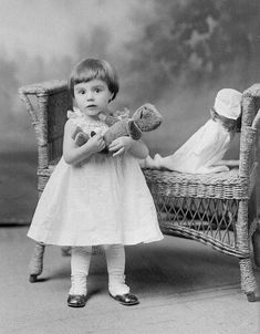 Sweet toddler and her teddy bear.