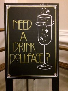 Having a Roaring Twenties themed or Great Gatsby wedding or event?! Want to add some glitz, glamour, and that chic extra touch to your evening party event?! Then you need a Gatsby Quote Sign! which means you need a custom created sign!!! This Need A Drink Dollface sandwich board sign was completely designed with your occasion in mind. Spice up your wedding or party table décor using this fun Art Deco font inspired sign. This 5 x 7 self-standing sign has been painted all black and features…