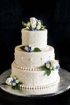 Ivory three tiered wedding cake.